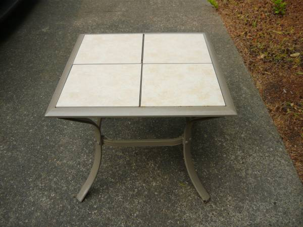 Photo OUTDOOR TILE TOPPED PATIO TABLE WITH COVER - $20 (LINCOLN CITY)