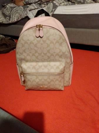 Photo pink, black and beige coach backpack - $250 (Eugene)