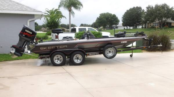 Photo 19.539 Skeeter Bass Boat, 200 HP Outboard  Trailer - $12,800 (Tavares)