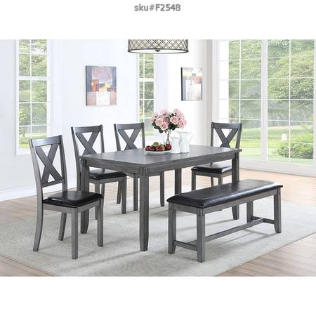 Photo 6-piece grey dining set with bench and 4 chairs - $599 (clermont)