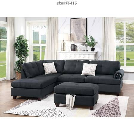 Photo Black or blue grey reversible sectional with ottoman - $799 (Clermont)