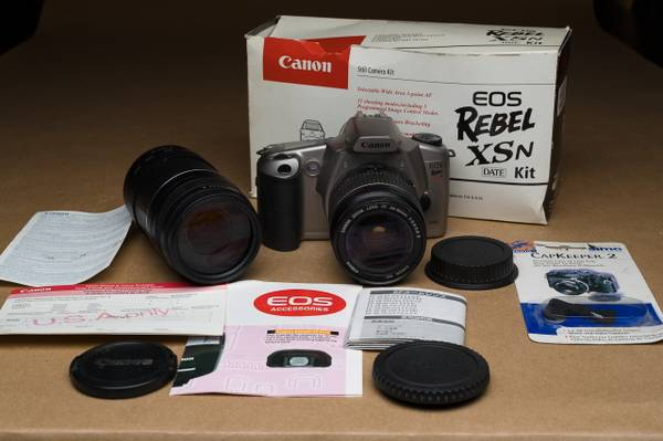 Photo Canon Rebel XSn plus two Canon zoom lenses. FILM Camera - $60