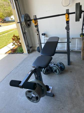 Photo Exercise Adjustable workout gym bench press with weight plates and bar - $400 (Winter Springs)