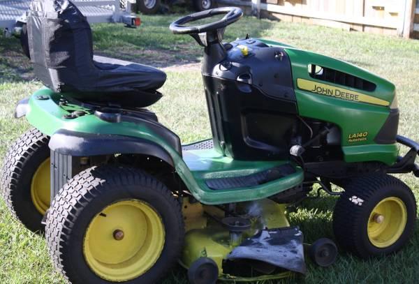 Photo John Deere LA 140 23 HP, 48quot 3 blade deck . - $900 (PoincianaKissimmee)