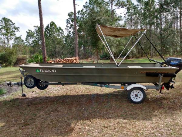 Photo Jon Boat  20 HP Tohatsu Outboard - $5000 (East Orlando)