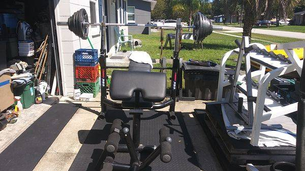 Photo Olympic bench squat rack combo 255 lbs of Olympic grip weights fat bar - $1,000 (deltona)