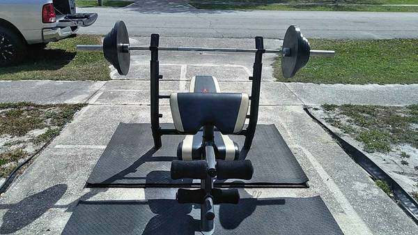 Photo home gym weight bench with weights $375 firm - $375 (deltona)