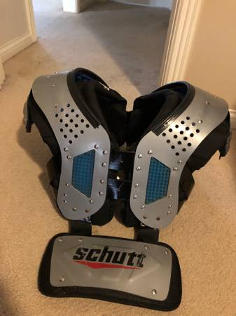Photo Football shoulder pads and back plate - $70 (Louisville)
