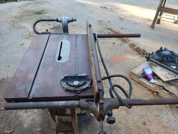 Photo a vintage Delta Rockwell 10quot tilting table saw. - $475