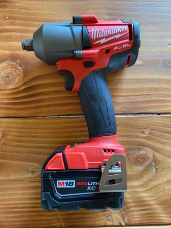 Photo Used Once- Milwaukee Mid Torque 12 Impact Wrench w 5.0 Battery - $180 (Yucca Valley)