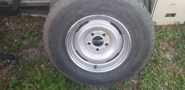 Photo Old school chevy wheels and tires - $100 (Panama city)