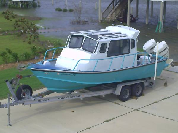 Photo 2339 aluminum cabin boat - $28,900 (Gulf Breeze)