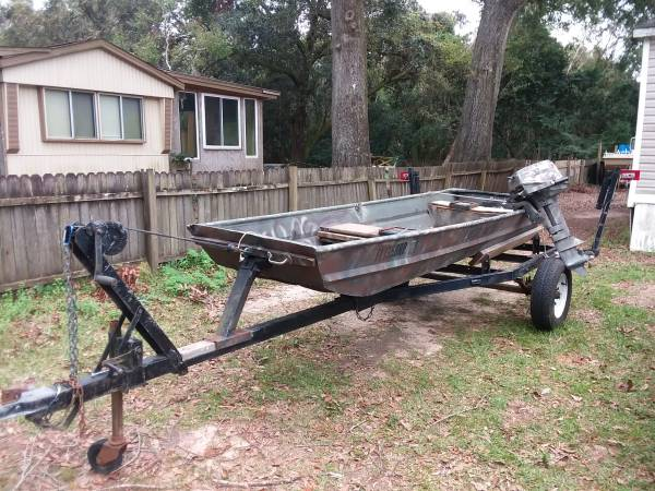 Photo Boat 9.9 Evinrude and Trailer - $1,000 (Pace)