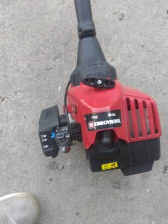 Photo A used gas trimmer used three times works perfect boughfibe months ago - $40 (Peoria)