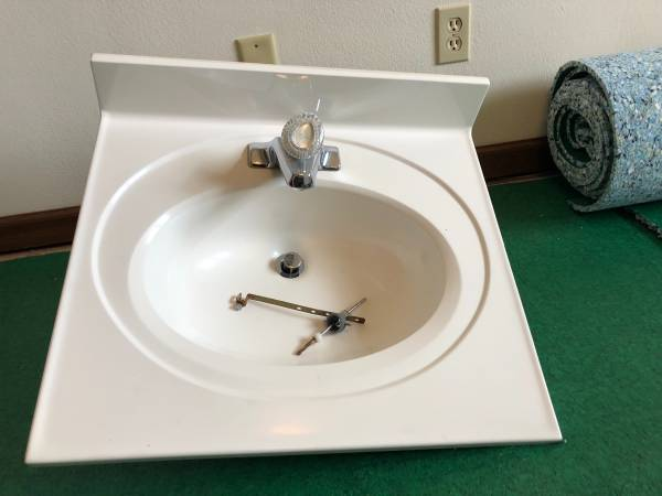 Used Bath vanity top with Moen faucet - $50 (410 W Cook St)