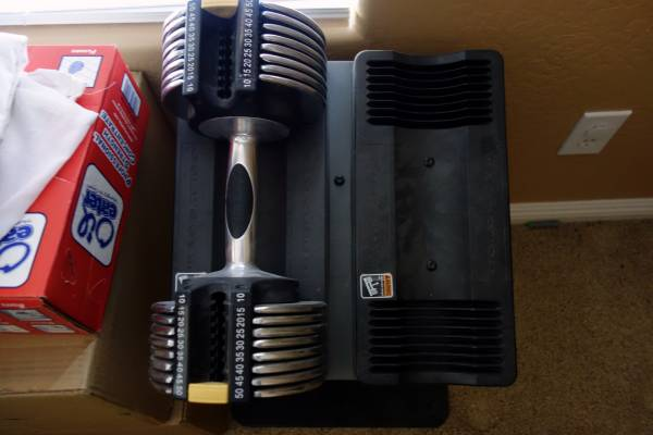 Photo GOLDS GYM SWITCH PLATE 50LB ADJUSTABLE WEIGHT DUMBBELL WSTAND - $150 (Anthem (Far N Phx))