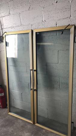 Photo Two Commercial refrigerator glass doors - $100 (Pittsburgh)