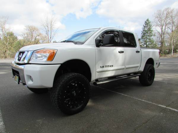 Photo 2010 LIFTED NISSAN TITAN SE CREW CAB 4X4 99K MILES - $16695 (11812 NE HWY 99)