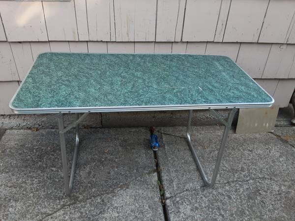 Photo 4 ft aluminum frame folding table - $30 (NE portland)