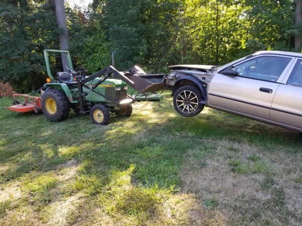 Photo John Deere 770 4x4 Loader Tractor w power steering - $8500 (Battle Ground)