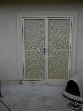 Photo Gatehouse Sunset 64-in x 81-in White Steel Surface Mount Double Door S - $200 (Prescott)