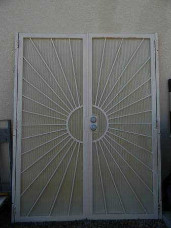 Photo Gatehouse Sunset 64-in x 81-in White Steel Surface Mount Double Door S - $175 (Prescott)