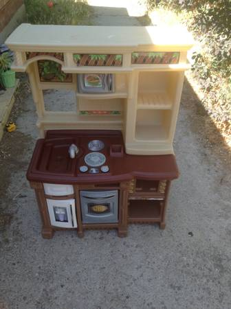 Photo Play kitchen for sale. Hours of fun - $18 (provo)
