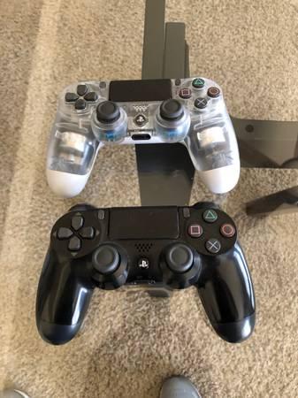 Photo 1 black 1 clear ps4 controller oem - $50 (Eagle ridge estates)