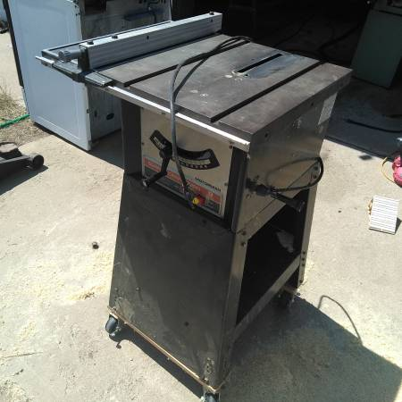 Photo Craftsman Table saw on rolling stand. - $150 (Sugar City)