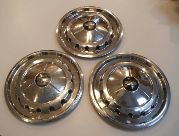 Photo 1957 Chevy  Old Ford HubCaps - $65 (Belleville, IL)