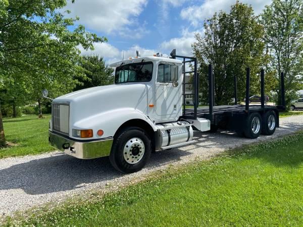 Photo 1992 International 9400 Twin Screw Logging Truck - $14,900 (NEW BLOOMFIELD, MO)