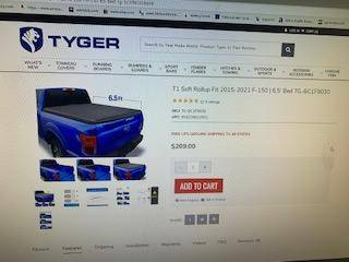 Photo FORD TONNEAU COVER ( NEW IN BOX - $140 (Springfield)