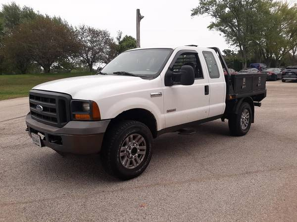 Photo 2006 FORD F250SD DIESEL 4x4 WITH FLATBED....ONLY 99k - $8,500 (WiIL border)