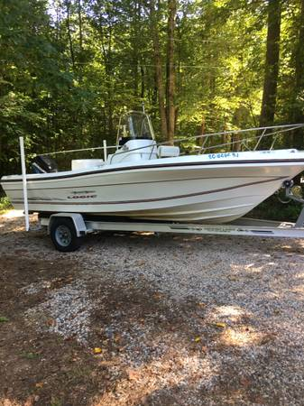 Photo 2001 Logic Triumph 21 center console boat 150hp - $10,000 (Wake forest)