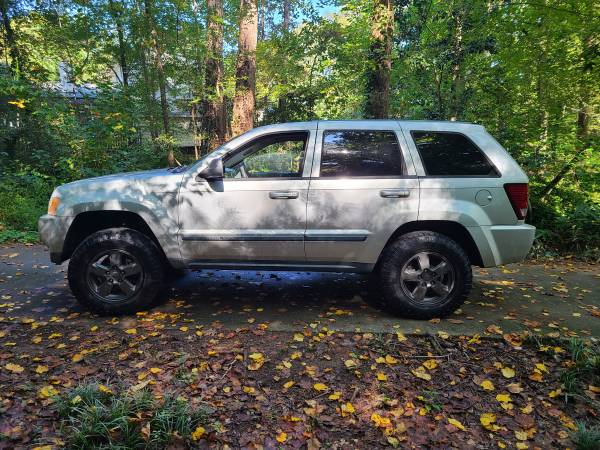 Photo 2007 Lifted Jeep Grand Cherokee 4x4 Laredo NEED GONE - $4,600 (raleigh)