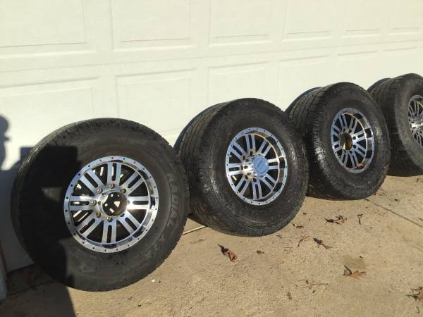 Photo 8 lug rims Dodge Ram n older Chevy - $200 (Cary)