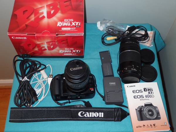 Photo Canon Rebel XTi DSLR Camera With Lots of Extras Like New Condition - $250 (Garner)