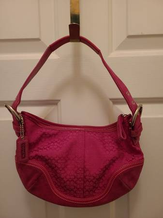 Photo Coach pink small suede bottom - $30 (cary)