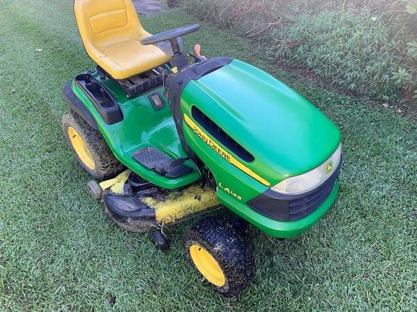 Photo John Deere Riding Lawn Tractor, Riding Mower Cuts and Drives Good - $950 (RaleighDurham)