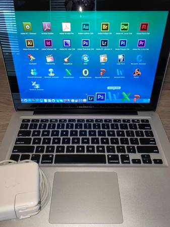 Photo Macbook Pro 13 i5 High Speed 500GB HD AdobeFinal Cut ProLogicPro - $499 (Holly Springs)