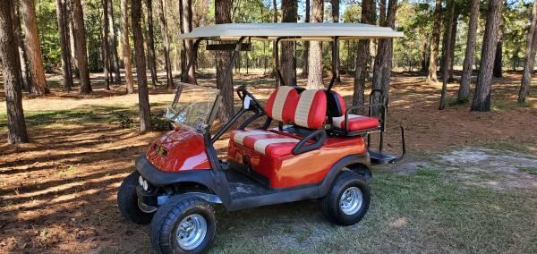 Photo Red lifted club car precedent model golf cart - $5,000 (Godwin)