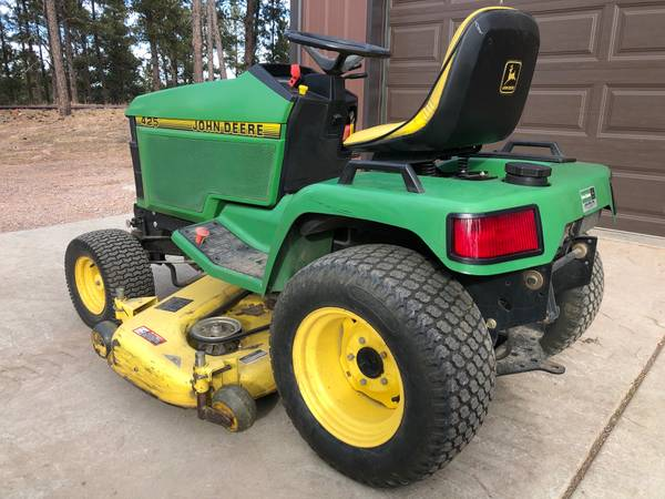 Photo John Deere 425 Lawn Tractor, Loader and Mower Deck - $5,950 (Rapid City)