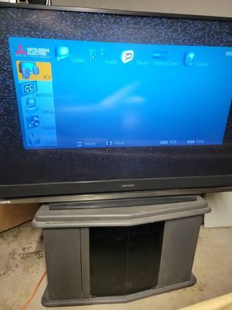 Photo 65quot Mitsubishi Projection TV wremote and Costco TV stand - $500 (Anderson)