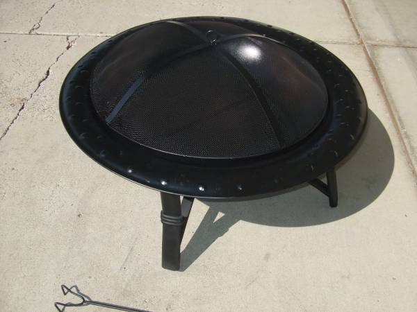 Photo Fire pit with cover and metal poker rod - $50 (Sparks Nv.)