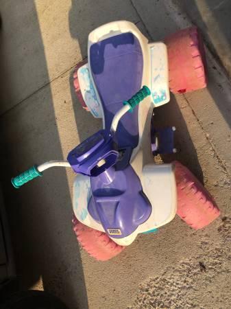 Photo Free Barbie power wheels and little girl bike (Telegragh)