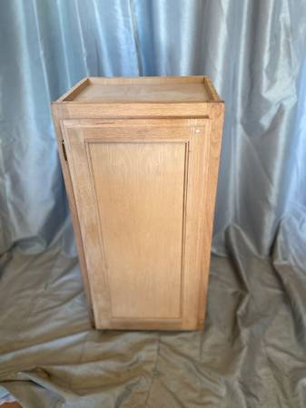 Photo Unfinished oak front kitchen cabinet - $20