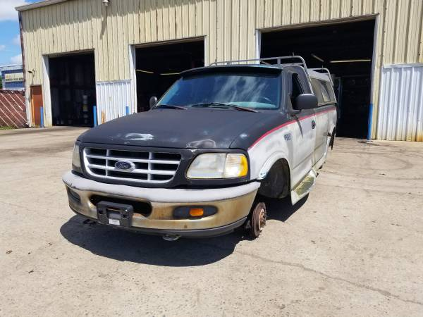 Photo Parting out 1997 Ford F-150Call for parts (New Paris)