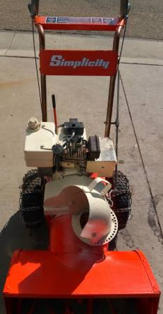 Photo Simplicity Snow blower with electric start  tire chain - $230 (Rochester)