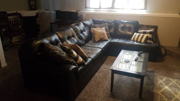 Photo Black Faux Leather Sectional Couch - $150 (Poplar Grove)