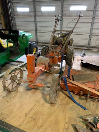 Photo gravely walk behind with attachments - $400 (GENOA)